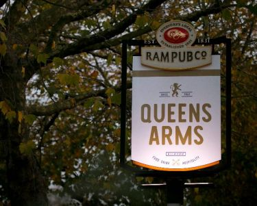 queens arms swing sign